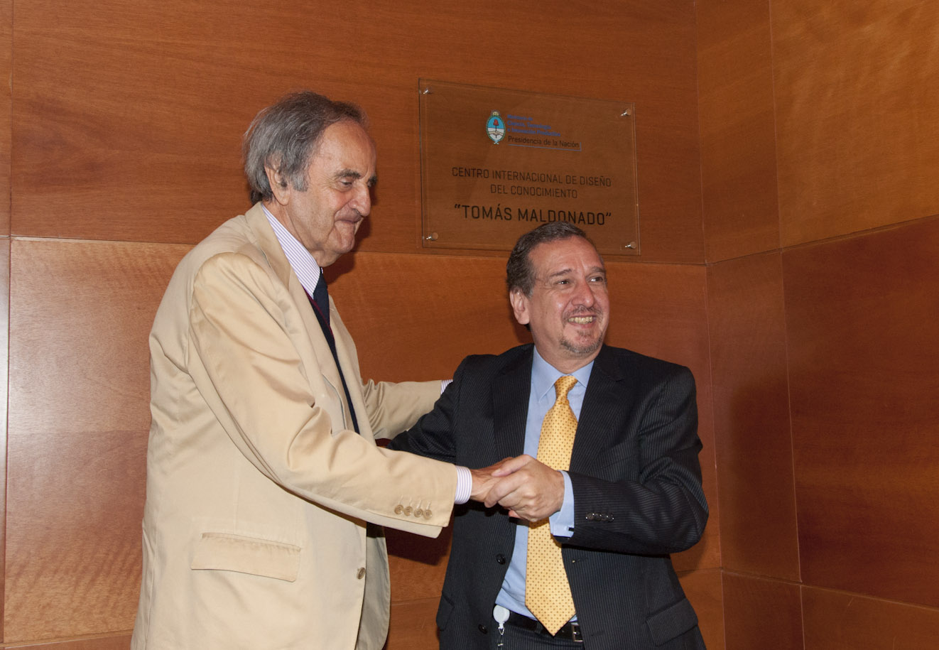 Barañao and Maldonado together in a master conference